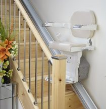 stair lift on tan stairs