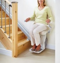 older woman on stair lift